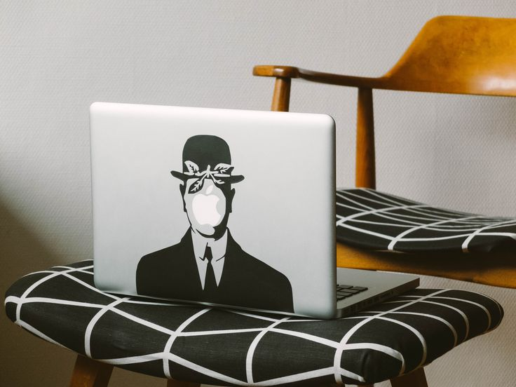 "Hand cut laptop sticker made from decorative vinyl. Inspired by Magrittes ""Son of man"""