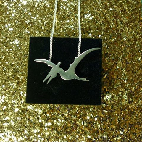 For the gal who loves dinos! The pterodactyls pendant is a hit! #dinosaur #science #slashpiledesigns #giftguide #handmade #holidayshopping #gift