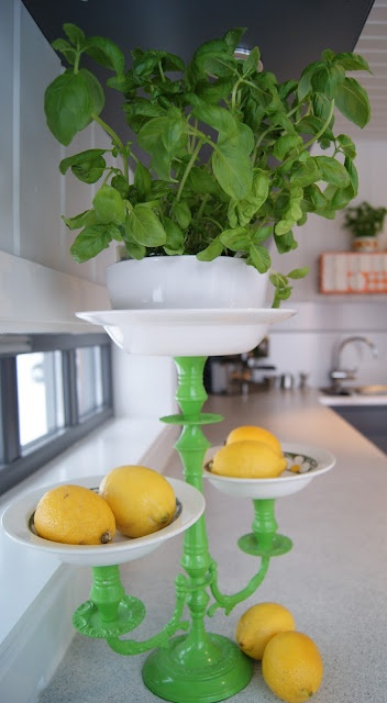 No use for fancy candlesticks?  Think again!  Argghhh- I love this!!! Maybe not the green paint so much, but the idea and ways to use those small vintage dishes.