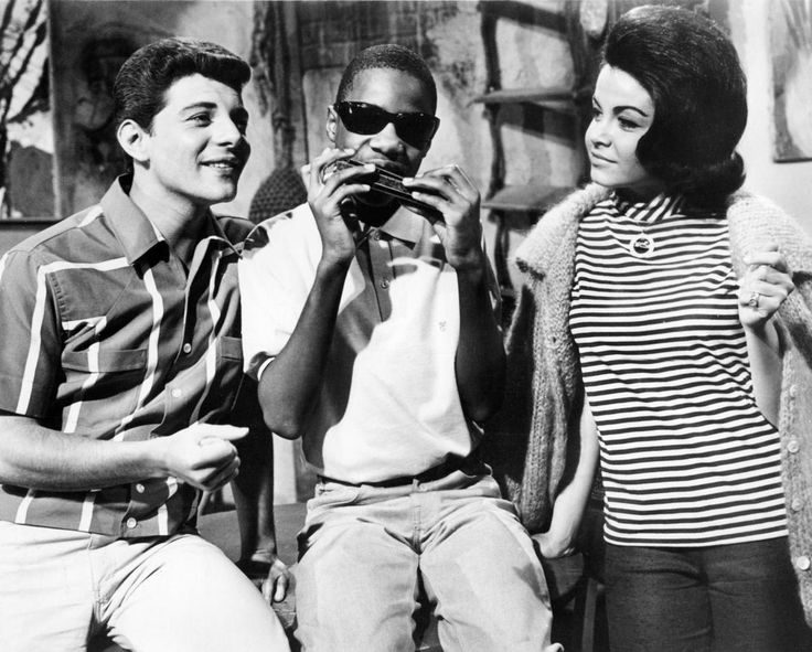 """Stevie Wonder stepped in front of the cameras at just 13-years-old and played himself in the 1964 film """"Muscle Beach Party"""" alongside Frankie Avalon and Annette Funicello in 1964."""