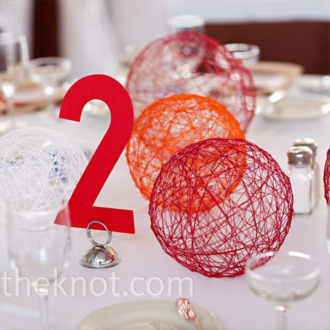 string balls out of colorful yarn and fabric stiffener.