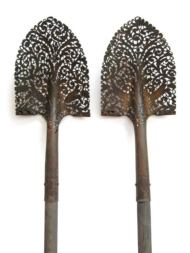 Bet I could get an old shovel at an estate sale and spray paint over a doily for the same effect.