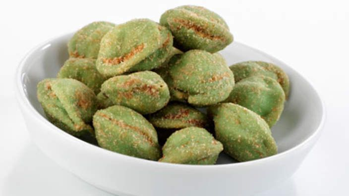 Wasabi peanuts | Spice up standard salted nuts with this recipe for wasabi-crusted peanuts. The green shell is made with a combination of beaten eggwhites, wasabi powder and wasabi paste.