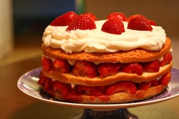 Strawberry Cream Cake ~ Beautiful three-layer strawberry cream cake for that special occasion.  Rich pound cake cut into three layers, filled with fresh strawberries, whipped cream, and strawberry puree.  Topped with whipped cream and strawberries. ~ SimplyRecipes.com