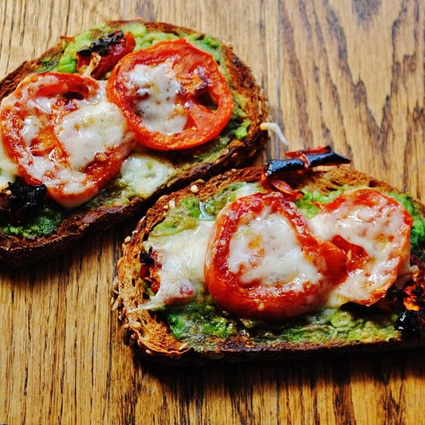 The most amazing toast in the entire world! Whole grain seed oat bread with avocado, roasted garlic, grilled tomato and broiled asiago cheese  so tasty tasted like an amazing version of pizza toast! Yummmm! Omg
