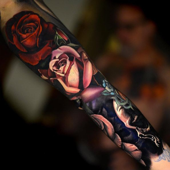 Rose sleeve tattoo by Nikko Hurtado Wow  I'm not the biggest fan of roses and i probably have enough on me as is, but these roses are so damn real it's difficult to remember they're fake. But it's the colors. Those colors are the work of more than just a tattoo artist, this comes from someone who sees the world as a work of art and tattoos what should be instead of what is. It's perfect.