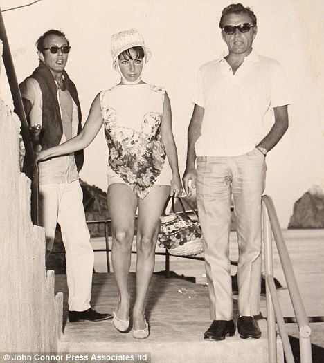 Elizabeth Taylor and Richard Burton arrive on the island of Capri in June 1962.