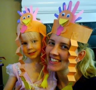 Cute Turkey headbands for Family Thanksgiving Feast. I like how the child's handprints make the feathers for the turkey!