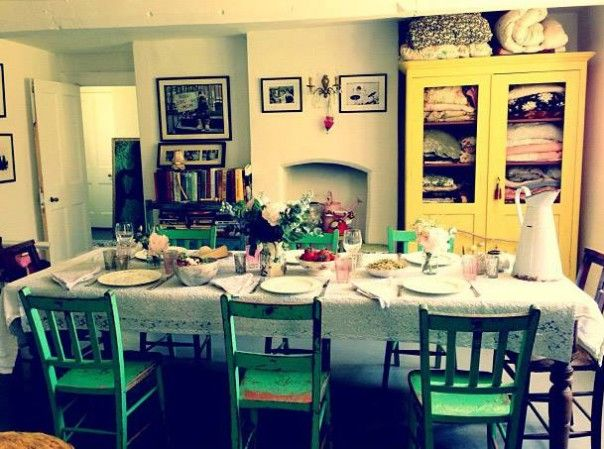Pearl Lowe new dining room with table laid out I especially like the yellow cupboard full of blankets and quilts...