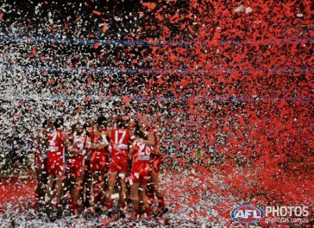 Sydney Swans players celebrate on the podium after the presentation at the 2005 AFL Grand Final between the Sydney Swans and the West Coast Eagles at the Melbourne Cricket Ground September 24, 2005 in Melbourne, Australia.