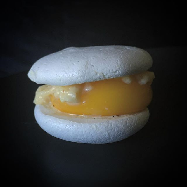 An egg reborn. Savory shallot and white pepper macaron, sous vide egg yolk & pattypan fromage fort. 🍳 #CookItWithColor @epicurious