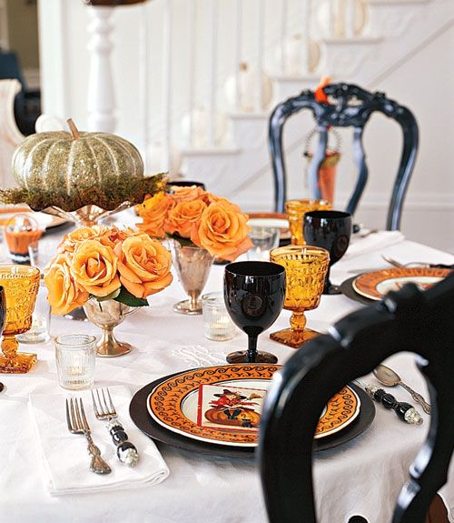 Table Setting    Orange flowers and simple, but colorful, dishes add adult style to a Halloween dinner party.