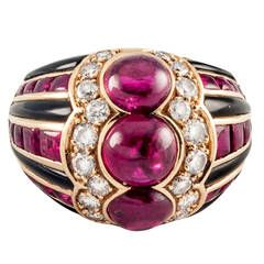 view this item and discover similar dome rings for sale at 18 kt gold ring set with black enamel and buff top rubies centering 3 cabochon rubies