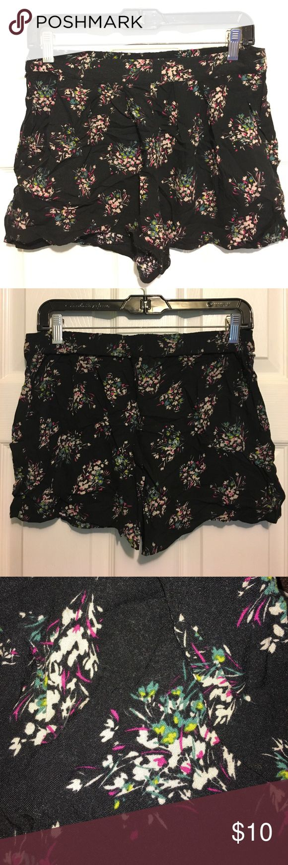 Xhilaration Floral Shorts with Pockets These shorts are breezy and beautiful! The print is pretty in muted teal, pink, and cream flowers, making this the perfect neutral for bright sunny days. Small tear on the right side under the waistband, but can be easily sewn up. Xhilaration Shorts