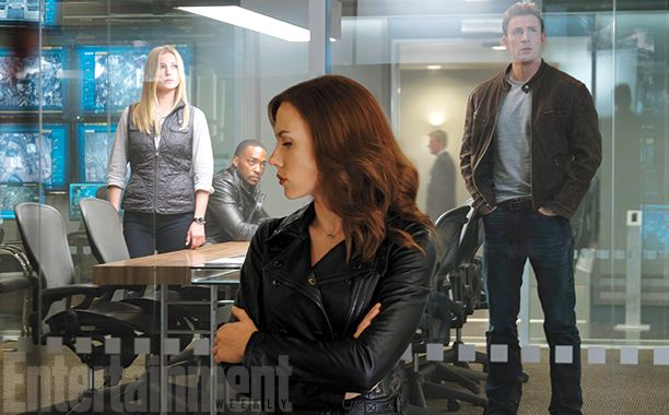 This scene is set an an international intelligence operations center, with Sharon Carter (Emily VanCamp), in the background with Anthony Mackie's Falcon and Chris Evans' Captain America, with Black Widow (Scarlett Johansson) on the opposite side of the glass. Carter, whose relation to his World War II flame Peggy Carter hasn't been established yet in the films, became a love interest for Cap in the comics. #CaptainAmericaCivilWar