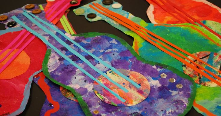 Students used painted paper loaded with glitter paint, cut out a guitar shape then added the razzle dazzle, sequins, tempera paint pattern...