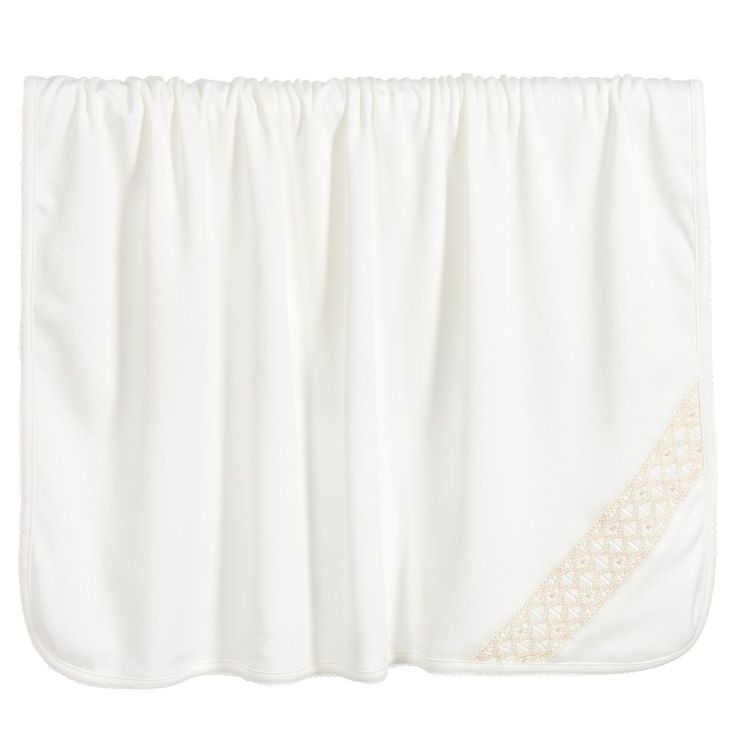 Beautiful ivory baby blanket fromBebe Bombom, made in a double layer of luxuriously soft, organic pima cotton jersey. One corner is richly hand smocked in a beige zigzag pattern, with ivory embroidered trim on the outer edges. This versatile blanket is ideal for wrapping around baby, as a cosy layer in the pram or stroller, or even for placing on the floor as an impromptu play mat.