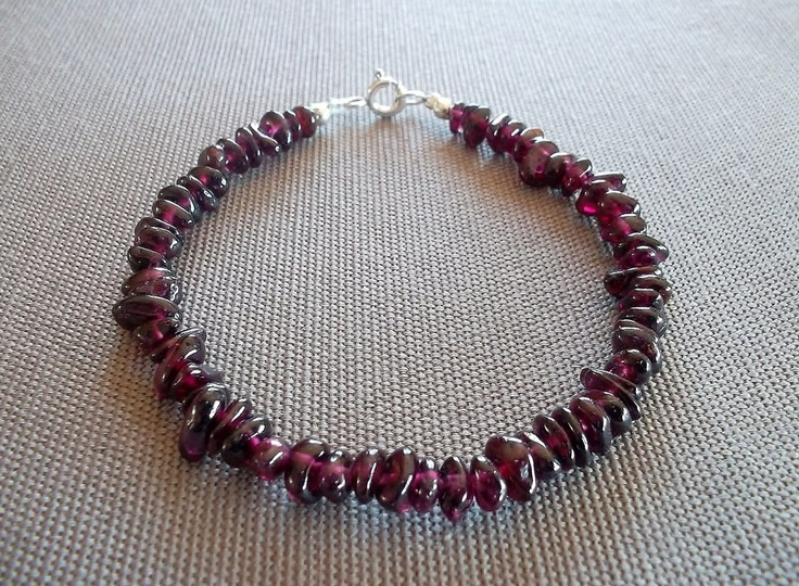 Handcrafted bracelet featuring deep red genuine garnet chip beads. 8 inches in length, with a sterling silver clasp.