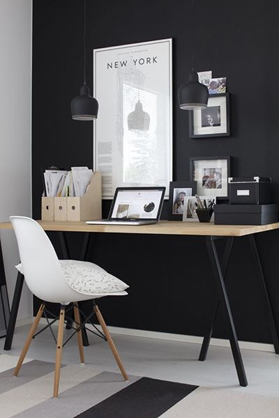 Black, white & wood workspace with black wall, Eames chair & Hay Loop desk stands | @styleminimalism