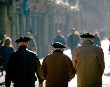 Men with boinas in the Casco Viejo of Bilbao.