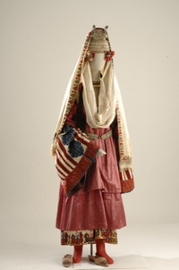 This costume, worn by brides or betrothed girls in Astipalaia, is called a…