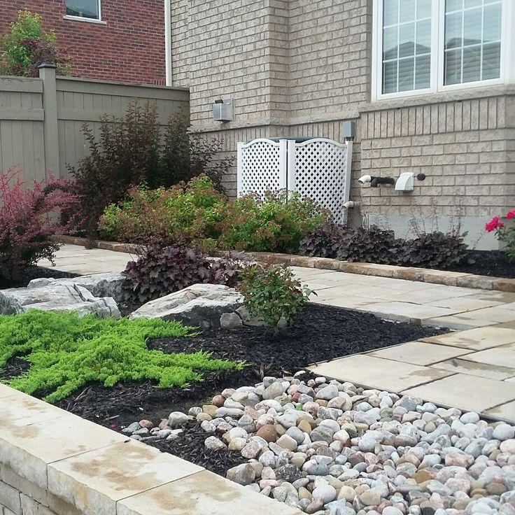 Low maintenance garden, walkway,retaining wall.