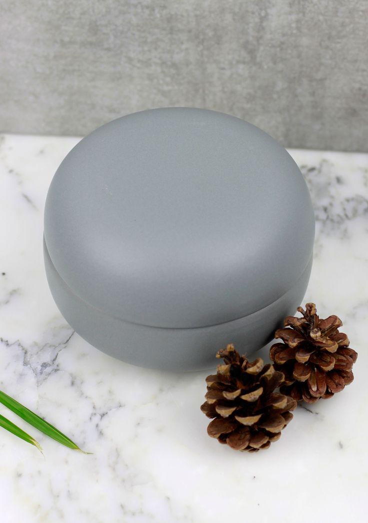 Grey lidded ceramic pots with a smooth, matt finish.  These pots are super versatile making them perfect for almost anything, from teabags to jewellery!   Select from size small, medium or large or as a set of 3. Price starting from £12!