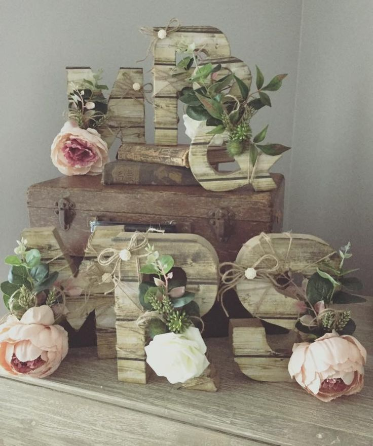Mr and Mrs letters complete with silk flowers and fake wood paper