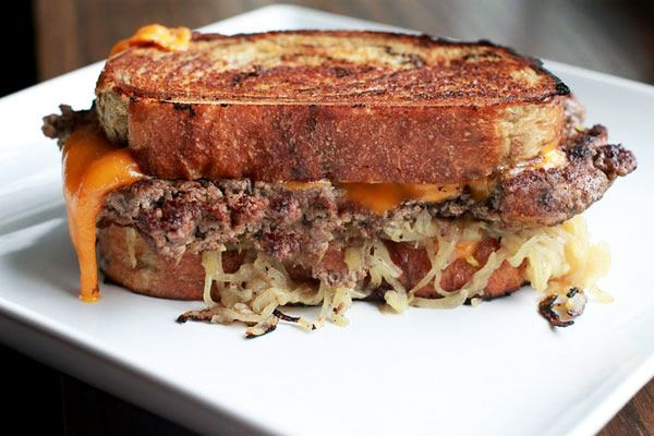 Classic Patty Melt on Buttery Rye Bread with Cheddar, Caramelized Onions and Sriracha Mayo