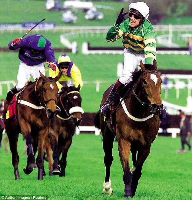 The mighty Istabraq (23.5.1992 by Sadlers Wells, (winning his second or is it his third Champion Hurdle at the Cheltenham Festival 1998-2000; can't see Charlie's fingers properly). Ridden by his regular jockey, Charlie Swan, trained by Aidan O'Brien (Ire) - before he changed to the flat, and owned by one of the biggest owners in NH Racing - J.P. McManus. He also won the Irish Champion Hurdle 1998-2001.