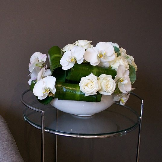White flower arrangement with Orchids & Roses