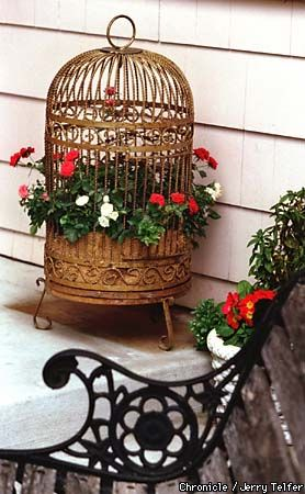 Garden Decor - Repurpose old, rusty birdcages into new, beautiful garden displays