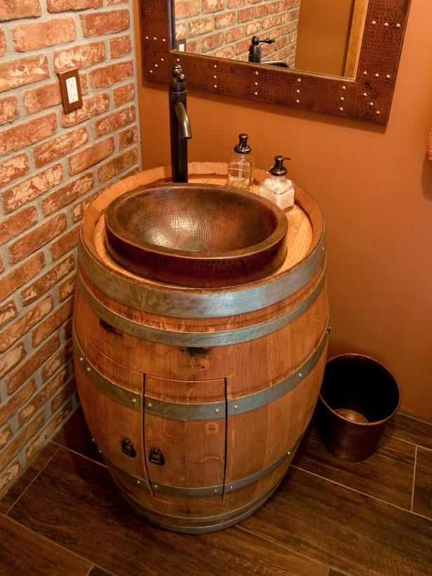 Real oak wine barrels make beautiful furniture. We love this barrel vanity.