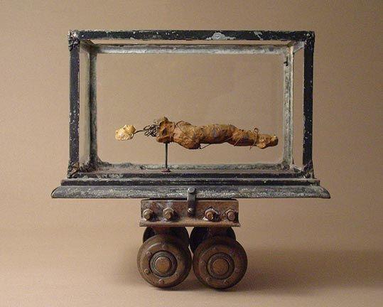 Breach of Contract (terrarium, ceramic figure study, plaster head, industrial carriage, wire) 2006, James Michael Starr
