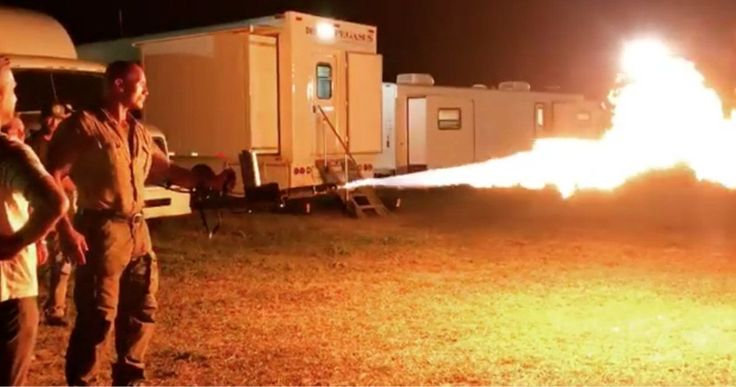 The Rock Shows Off His Flamethrower in Jumanji 2 Set Video -- Dwayne Johnson shows off his new flamethrower from the set of Jumanji 2, while praising fans that dressed up as his previous characters for Halloween. -- http://movieweb.com/jumanji-2-dwayne-johnson-flamethrower-video/