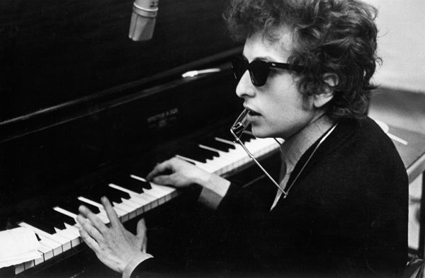 "Bob Dylan's 1965 classic ""Like a Rolling Stone"" finally has an official video. The video is interactive, allowing viewers to flip through 16 television channels as a variety of television personalities lip-sync the lyrics."