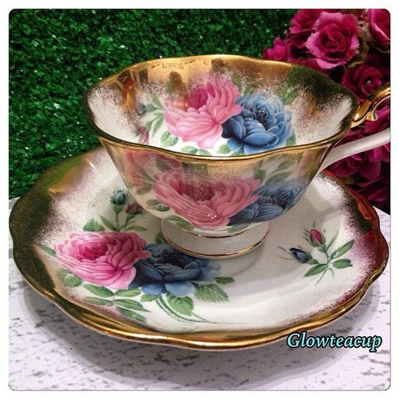 Royal Albert with pink and blue roses, heavy gold tea cup and saucer