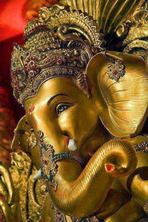 Exquisite  metal plated Ganesha Murthi, with a golden shimmer :}