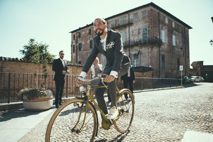 Groom in Zara Man Suit riding a bicycle to the wedding | Industrial Wedding | Destination Wedding | Italy | Intimate Reception | Images By Maria Bryzhko | http://www.rockmywedding.co.uk/lara-fabio/