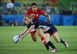 Canada's Bianca Farella puts pressure on Danielle Waterman.