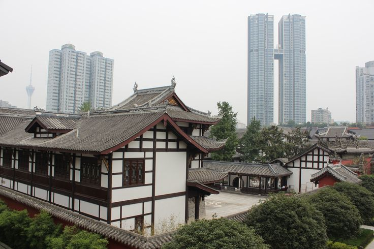 Chengdu old and new. Traditional buildings in the centre of Chengdu are overshadowed by the new skyscrapers of 21st century Chengdu.