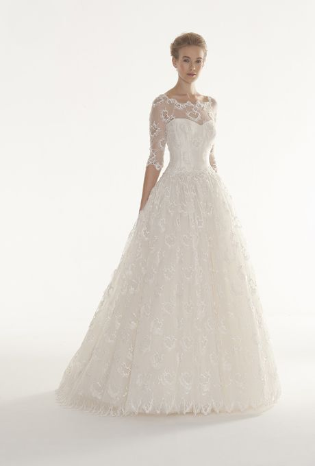 "Brides.com: Langner Couture - 2013. ""Walking on Clouds"" beaded organza ball gown wedding dress with a sweetheart bodice, tulle illusion neckline, and three-quarter sleeves, Langner Couture  See more Langner Couture wedding dresses in our gallery."
