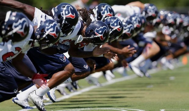 Houston Texans players run during an NFL practice session in Houston.  . Photograph: David J. P...