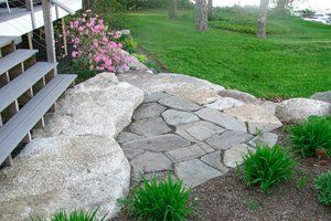 Dress up the transition from your deck to your yard with a little hardscaping
