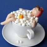 cupcake in een kopje badeend badderen bubbels