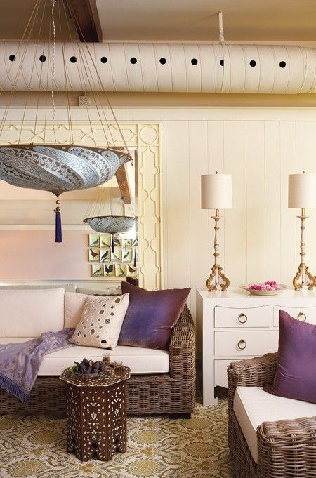 Purple Rooms   House & Home - Luxurious elements such as a large silk pendant light, intricately carved table lamps, a dramatic, oversized mirror, velvet cushions in a deep violet and an inlaid side table all work together to create a luxurious, well-travelled style.