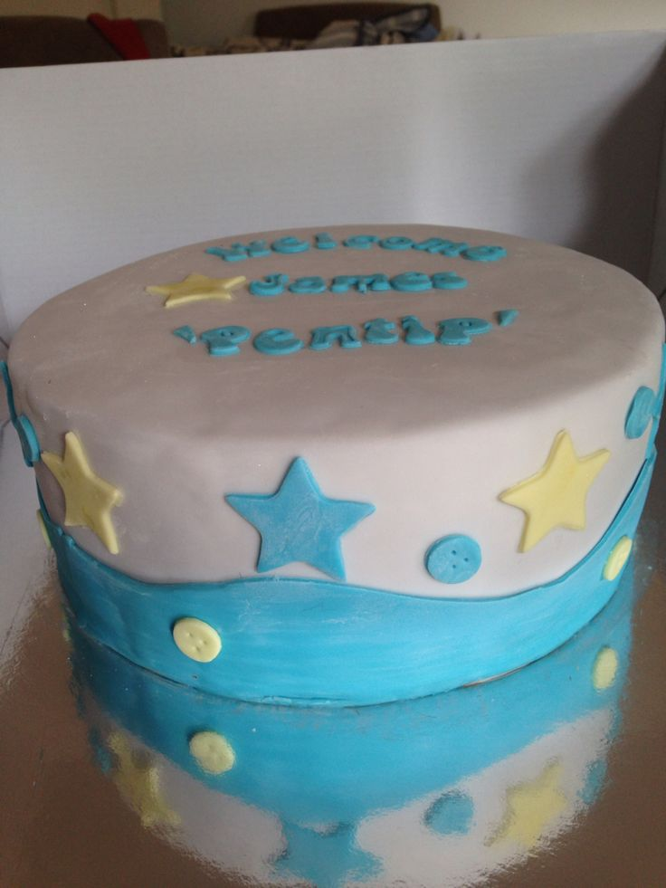 Chocolate and red velvet layers. Welcome baby cake. Fondant covering.