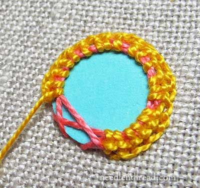 Shisha – embroidery with mirrors – can be worked different ways. This is a very detailed tutorial, with lots of pictures.