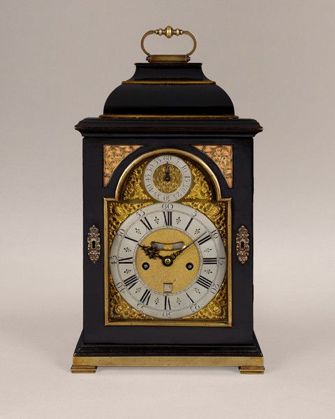 An ebony bracket clock by Simon De Charmes was a French Huguenot clockmaker working in London where he arrived in 1688. He was a refugee from France after the Revocation of the Edict of Nantes in 1685 by Louis XIV. The resulting exodus of Huguenot workers deprived French industry of some of their finest craftsmen and had a dramatic affect upon English furniture, silverware, tapestries and of clocks. He became a Free Brother of the Clockmakers' Company in April 1691 and was active at the Sign…