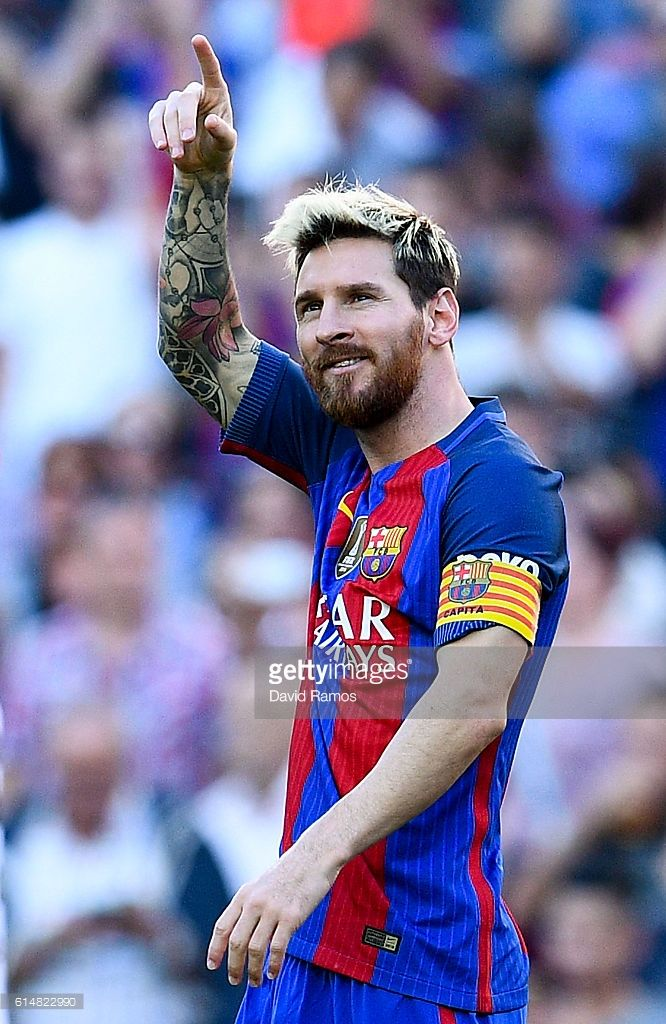 Lionel Messi of FC Barcelona celebrates after scoring his team's fourth goal during the La Liga match between FC Barcelona and RC Deportivo La Coruna at Camp Nou stadium on October 15, 2016 in Barcelona, Spain.